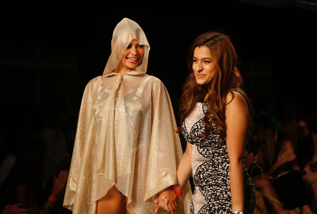 Natalia Velaquez (right) is congratulated after winning the top award for men's swimwear.
