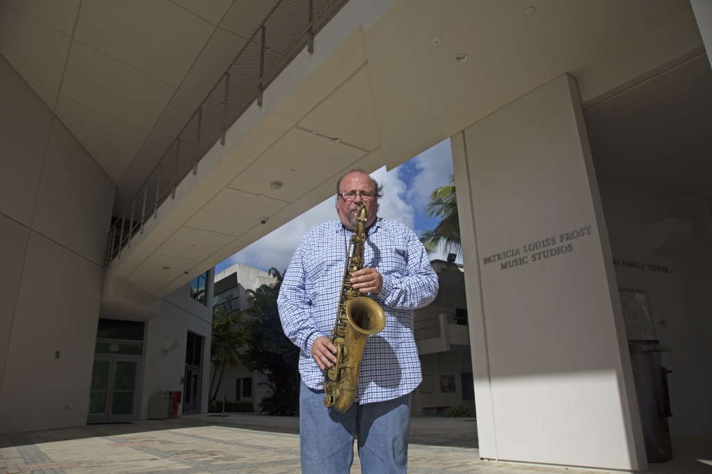 Ed Calle plays his saxophone outside University of Miami music studios. (Photo by Devoun Cetoute)