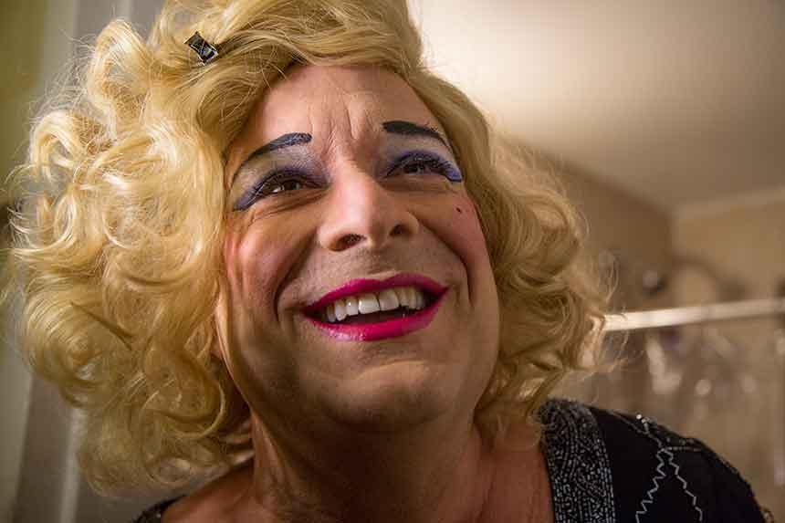 Shelley Novak prepares to leave her apartment for the short walk to Score, a drag bar in South Beach. Novak is the hostess at the club.