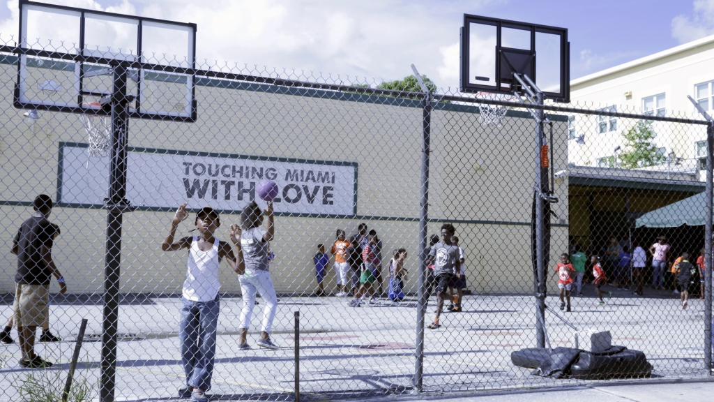 TIP OFF: Children play basketball outside the Touching Miami With Love non-profit resource center in Miami's Overtown neighborhood. (Phots by Kyle Wood)