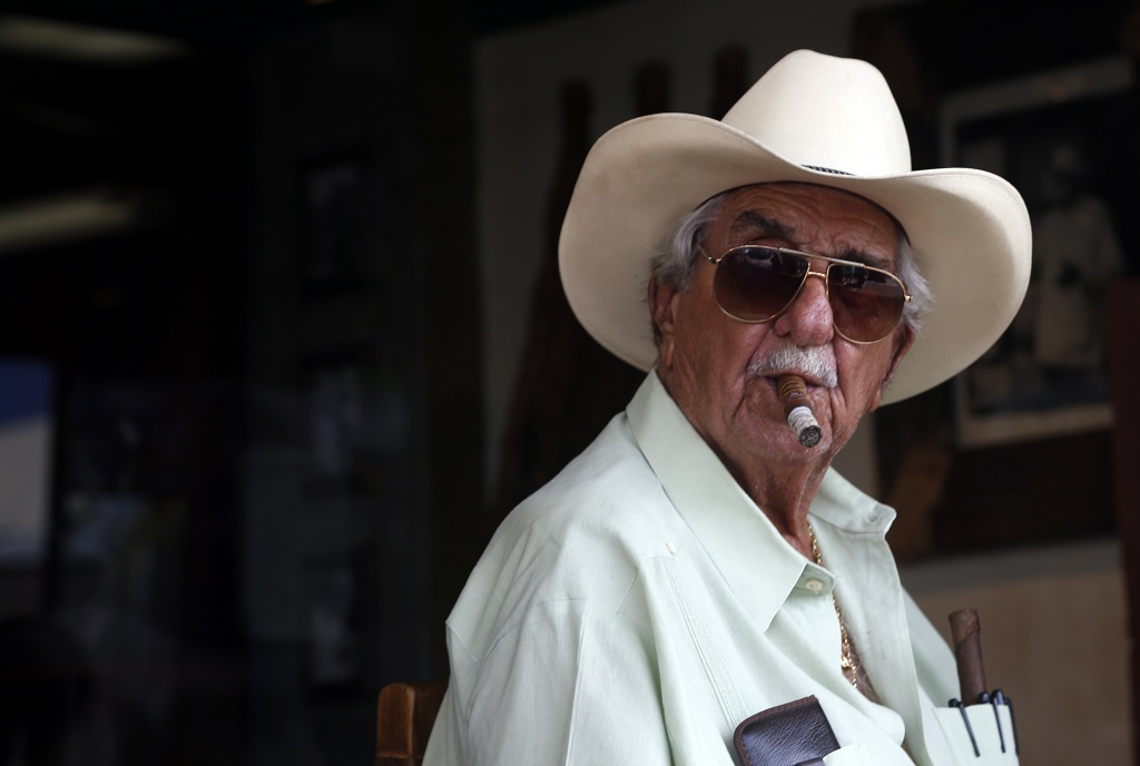 Cuba Tobacco Cigar Co. founder Don Pedro Bello has been selling handrolled cigars in Little Havana since 1994. (Photo by Uma Chatterjee)